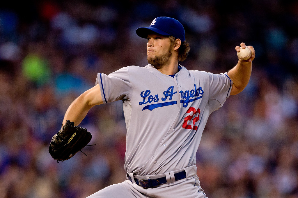 . DENVER, CO - JULY 2:  Starting pitcher Clayton Kershaw #22 of the Los Angeles Dodgers delivers to home plate during the sixth inning against the Colorado Rockies at Coors Field on July 2, 2013 in Denver, Colorado.  Kershaw threw a complete game shutout, helping the Dodgers defeat the Rockies 8-0. (Photo by Justin Edmonds/Getty Images)