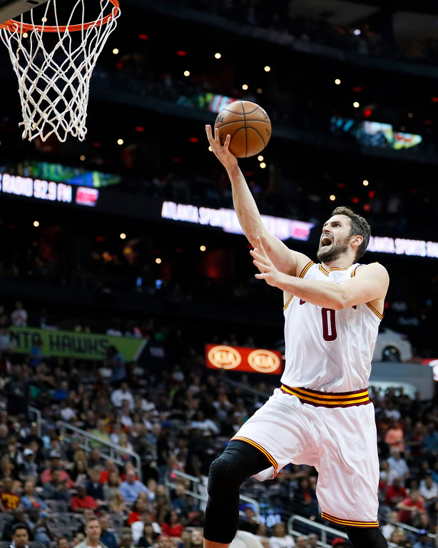 . Cleveland Cavaliers forward Kevin Love (0) goes up for the shot in the second half of an NBA basketball game against the Atlanta Hawks on Sunday, April 9, 2017, in Atlanta. The Hawks won in overtime 126-125. (AP Photo/Todd Kirkland)