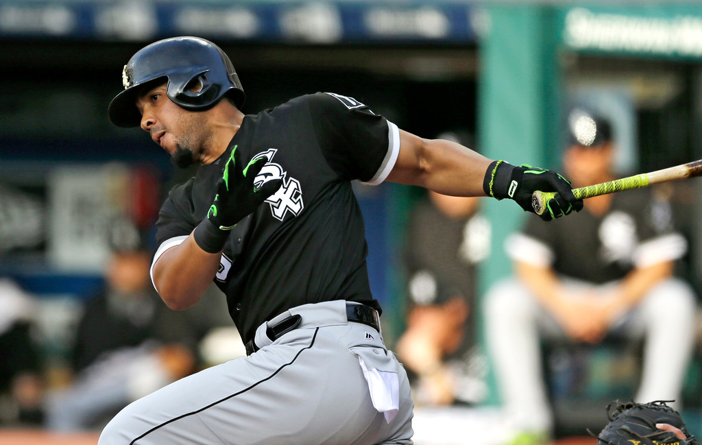 . Chicago White Sox\'s Jose Abreu hits an RBI-single off Cleveland Indians starting pitcher Josh Tomlin in the first inning of a baseball game, Saturday, June 10, 2017, in Cleveland. Tim Anderson scored on the play. (AP Photo/Tony Dejak)