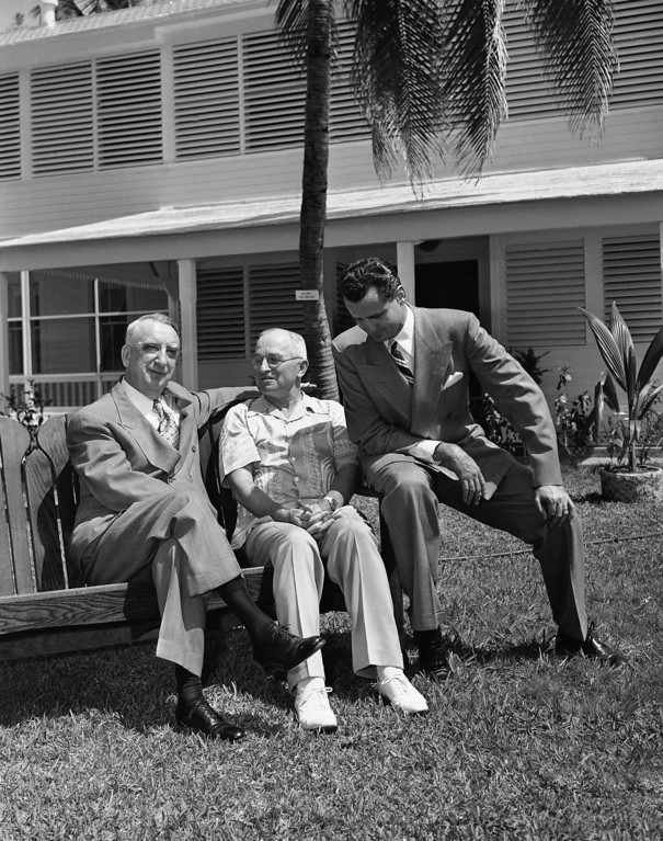 """. Chief Justice Fred M. Vinson paid President Harry S. Truman a visit at the \""""Little White House\"""" in Key West, Florida, on March 12, 1949.   Shown here on the lawn are left to right: Chief Justice Fred M. Vinson, President Truman and Representative George Smathers (D-Fla.).   Smathers drove Vinson from the airport to the \""""Little White House\"""" to see the President. (AP Photo)"""