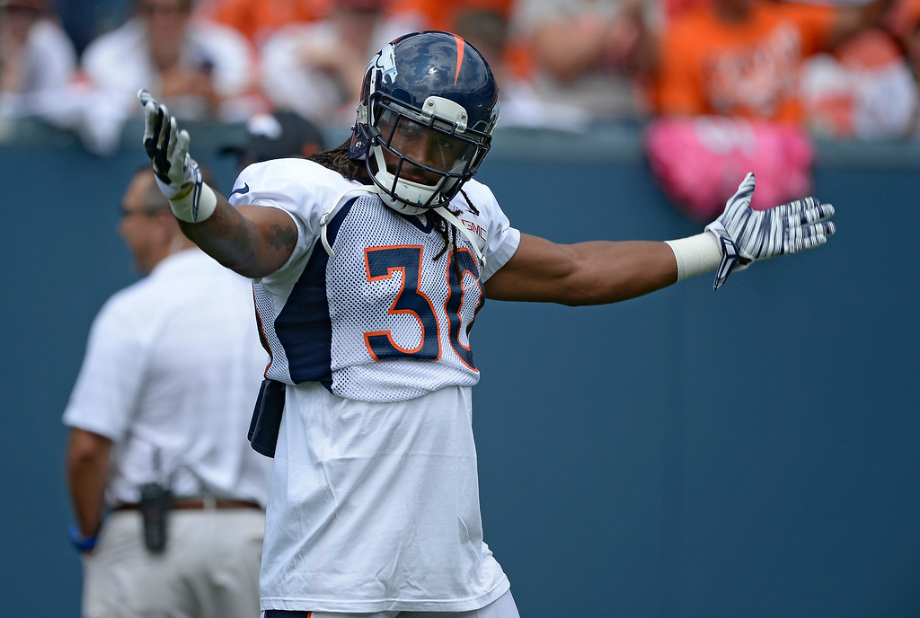 . Denver Broncos strong safety David Bruton (30) tries to get the crowd pumped on day four of the Denver Broncos 2014 training camp July 27, 2014 at Sports Authority Field at Mile High. (Photo by John Leyba/The Denver Post)