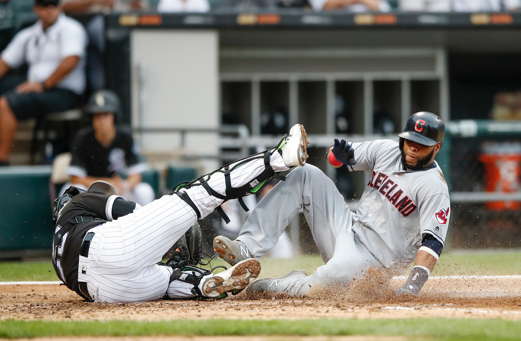 . Cleveland Indians\' Carlos Santana, right, scores on a single hit by Francisco Mejia off Chicago White Sox\' James Shields, as Omar Narvaez, left, is unable to tag him during the fourth inning of a baseball game, Monday, Sept. 4, 2017, in Chicago. (AP Photo/Kamil Krzaczynski)