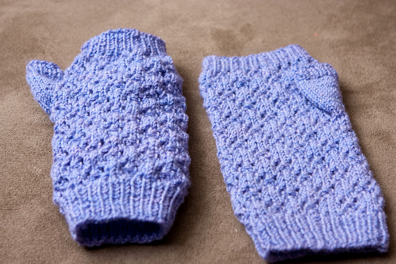 Snowflake Lace Mitts for Jessica M.. The mitt on the right has been blocked - it's much smoother than the unblocked lace on the left.