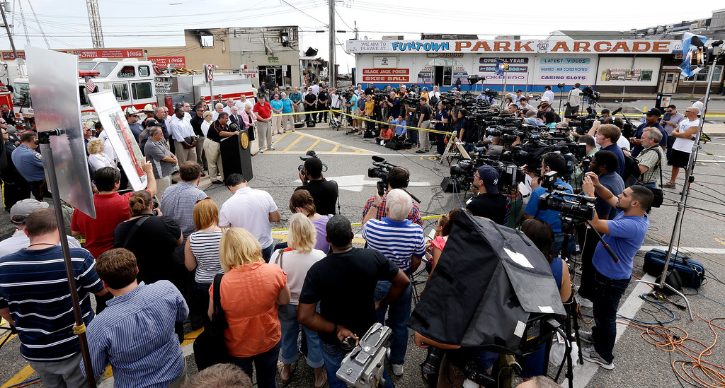 . A crowd of journalists attend a news conference with New Jersey Gov. Chris Christie, center left, the morning after a massive fire burned a large portion of the Seaside Park boardwalk, Friday, Sept. 13, 2013, in Seaside Park, N.J. (AP Photo/Julio Cortez)