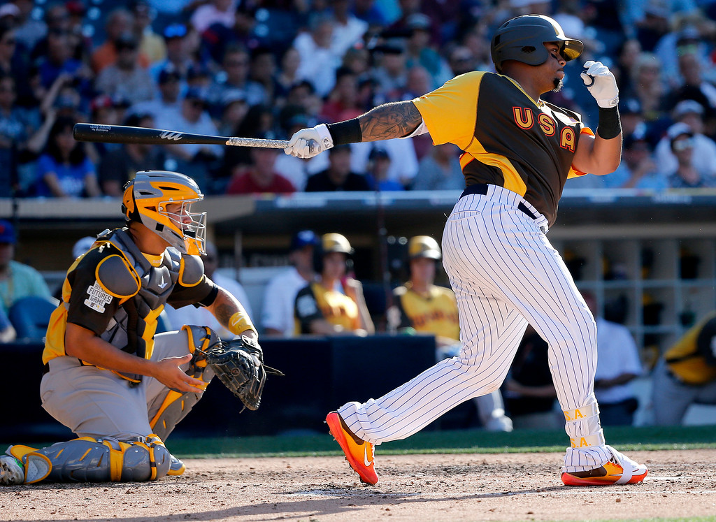 . U.S. Team\'s Dominic Smith, of the New York Yankees, hits against the World Team during the fifth inning of the All-Star Futures baseball game, Sunday, July 10, 2016, in San Diego. (AP Photo/Lenny Ignelzi)
