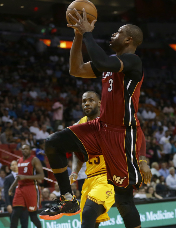 . Miami Heat guard Dwyane Wade (3) drives to the basket in front of Cleveland Cavaliers forward LeBron James during the second half of an NBA basketball game, Saturday, March 19, 2016, in Miami. (AP Photo/Lynne Sladky)