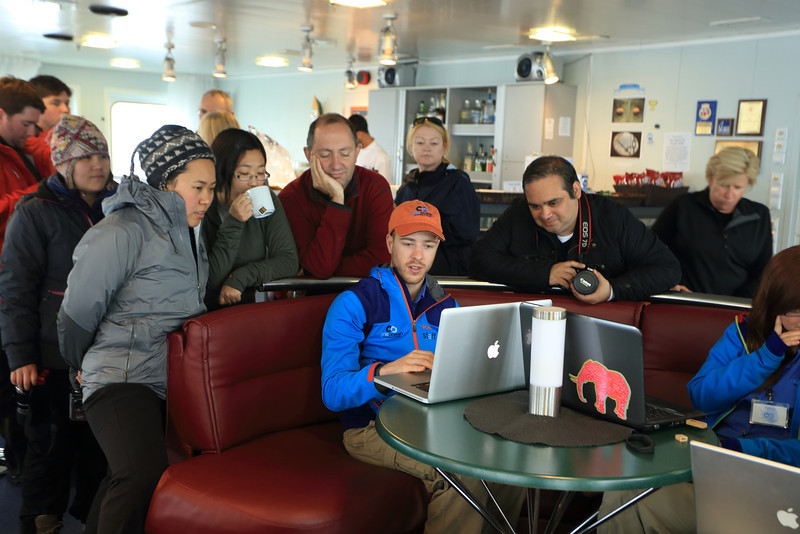 Antarctica - Jan 2013 - Sergey Vavilov Circle Trip, The One Ocean Expedition staff:   Kyle Marquardt (Photographer)  reviewing his shots in the lounge:   http://www.kylefoto.com