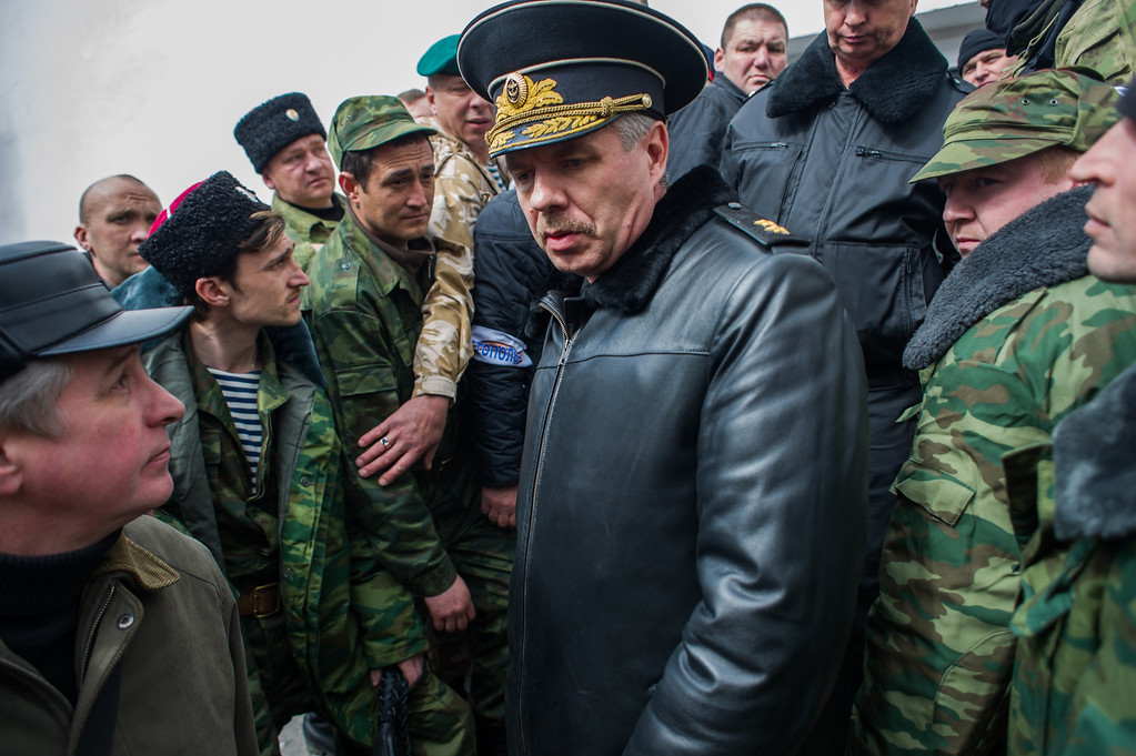 . Chief of the Russian Black Sea Fleet Alexander Vitko leaves the Ukrainian navy headquarters stormed by Crimean pro-Russian self-defense forces in Sevastopol, Crimea, Wednesday, March 19, 2014.  (AP Photo/Andrew Lubimov)