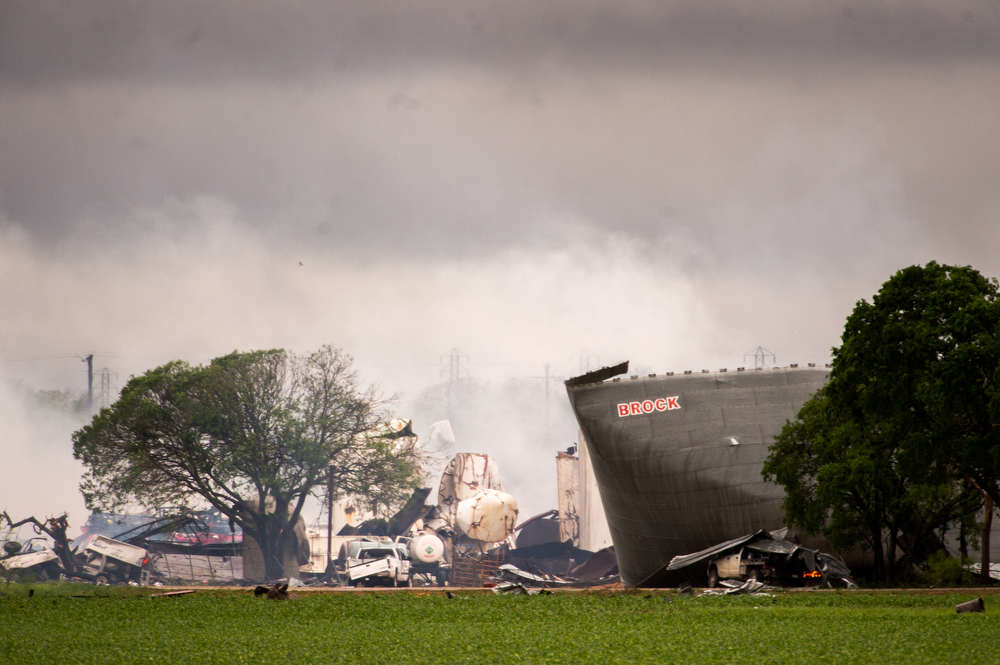 Description of . The remains of the the West Fertilizer Co. plant smolder in the rain on Thursday, April 18, 2013, in West, Texas.  A massive explosion at the plant killed as many as 15 people and injured more than 160, officials said overnight.   (AP Photo/Houston Chronicle,  Smiley N. Pool)