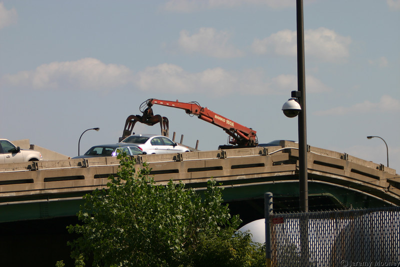 That truck was on the bridge when it collapsed, not getting ready to remove the car.