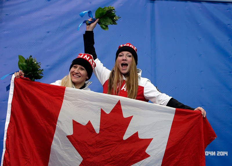 . The team from Canada CAN-1, pilot Kaillie Humphries, left, and brakeman Heather Moyse, celebrate their gold medal win after the women\'s bobsled competition at the 2014 Winter Olympics, Wednesday, Feb. 19, 2014, in Krasnaya Polyana, Russia. (AP Photo/Michael Sohn)