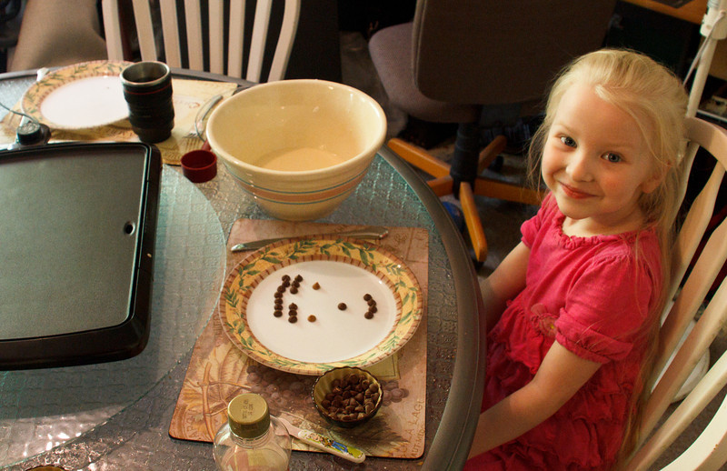 Chloe's ready to make pancakes with chocolate chips - April 2011