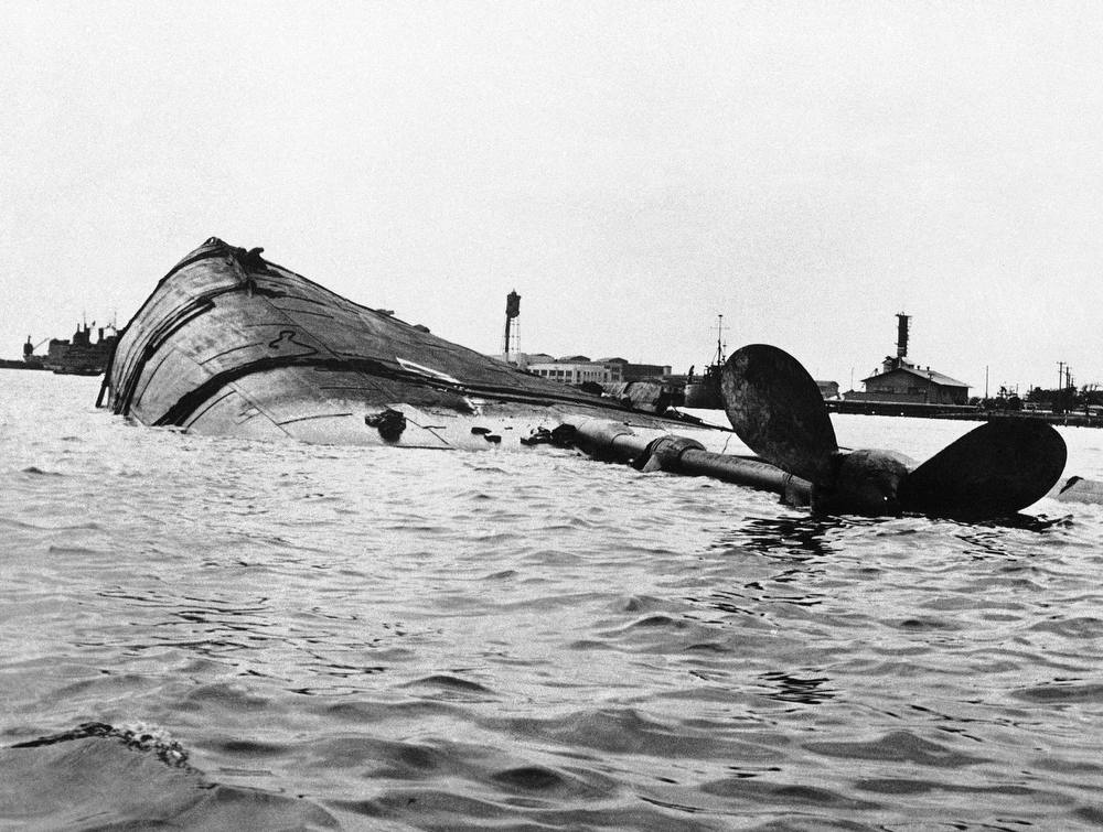 Description of . In this image provided by the U.S. Navy, a view of the capsized U.S.S. Utah after the Japanese aerial attack on Pearl Harbor, Hawaii on Dec. 7, 1941. (AP Photo/U.S. Navy)