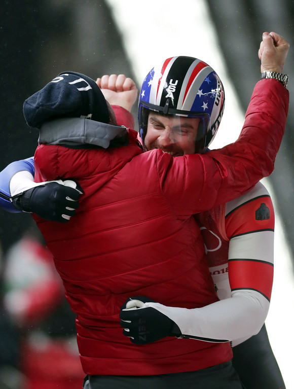 . Chris Mazdzer of United States celebrates his silver medal final run during final heats of the men\'s luge competition at the 2018 Winter Olympics in Pyeongchang, South Korea, Sunday, Feb. 11, 2018. (AP Photo/Michael Sohn)
