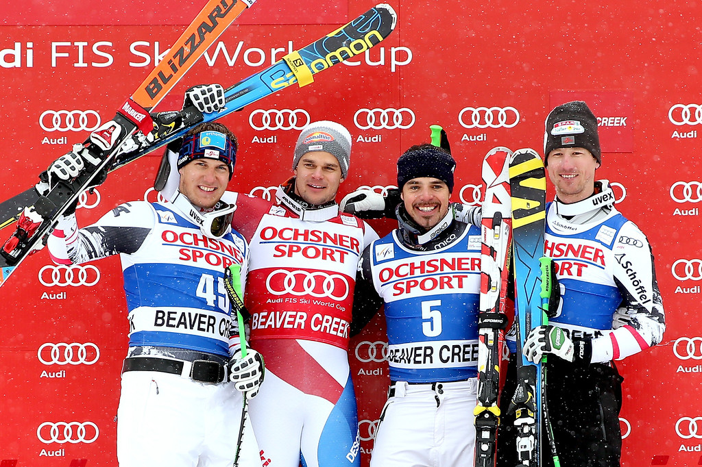 . Otmar Striedinger#45 of Austria, Patrick Kueng #28 of Switzerland, Peter Fill #5 of Italy and Hannes Reichelt #16 of Austria pose for photographers on the medal\'s podium during the men\'s Super-G race at the Birds of Prey Audi FIS Ski World Cup on December 7, 2013 in Beaver Creek, Colorado.  (Photo by Matthew Stockman/Getty Images)