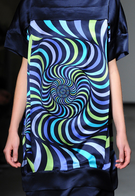 . A model wears a creation for Japanese fashion designer Atsuro Tayama\'s ready-to-wear Spring/Summer 2014 fashion collection presented in Paris, Wednesday, Sept.25, 2013. (AP Photo/Zacharie Scheurer)