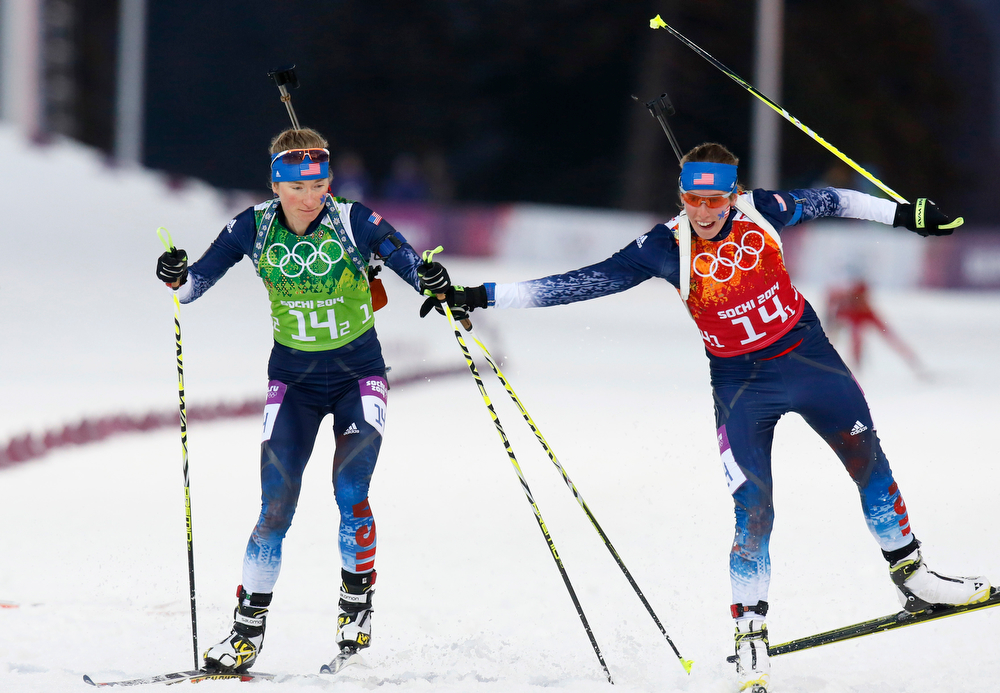 . United States\' Susan Dunklee, right, changes to Hannah Dreissigacker during the women\'s biathlon 4x6k relay, at the 2014 Winter Olympics, Friday, Feb. 21, 2014, in Krasnaya Polyana, Russia. (AP Photo/Dmitry Lovetsky)