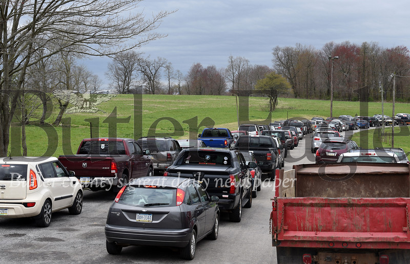 Harold Aughton/Butler Eagle: Hundreds of cars lined up outside the Big Butler Fairgrounds to pickup food distribued by the Greater Pittsburgh Community Food Bank on Tuesday, April 28, 2020.