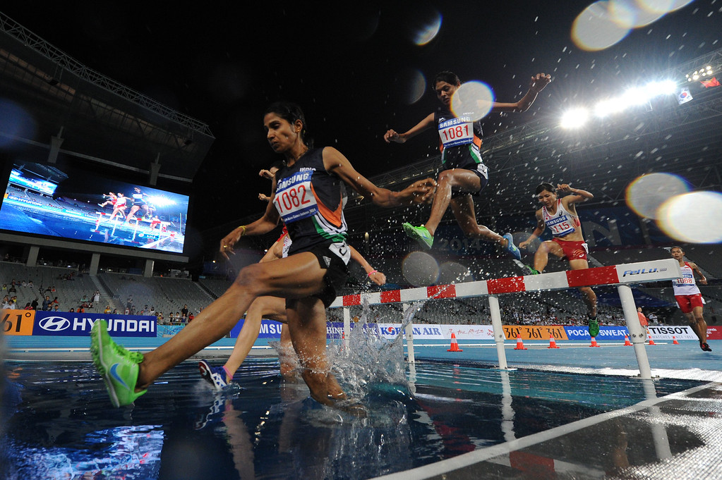 . (L/R): India\'s Sudha Singh (L) leads compatriot Lalita Shivaji Babar as they compete in the final of the women\'s 3,000m steeplechase athletics event during the 17th Asian Games at the Incheon Asiad Main Stadium in Incheon on September 27, 2014. PHILIPPE LOPEZ/AFP/Getty Images