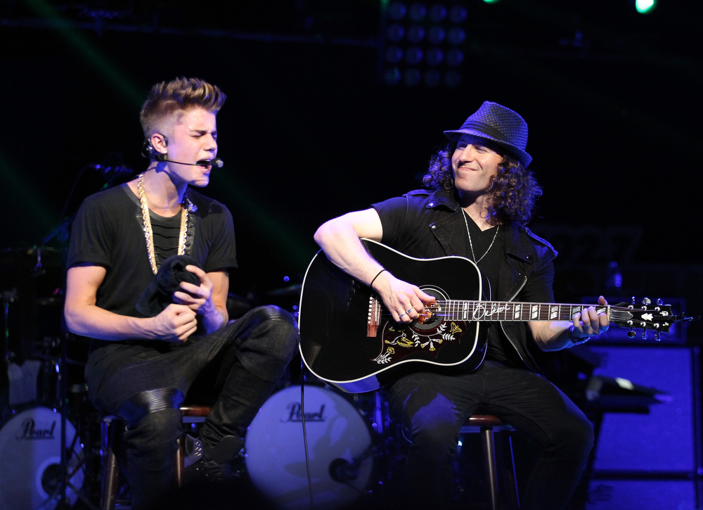 . Singer Justin Bieber and musician Dan Kanter perform onstage during KIIS FM\'s 2012 Jingle Ball at Nokia Theatre L.A. Live on December 3, 2012 in Los Angeles, California.  (Photo by Christopher Polk/Getty Images for Clear Channel)