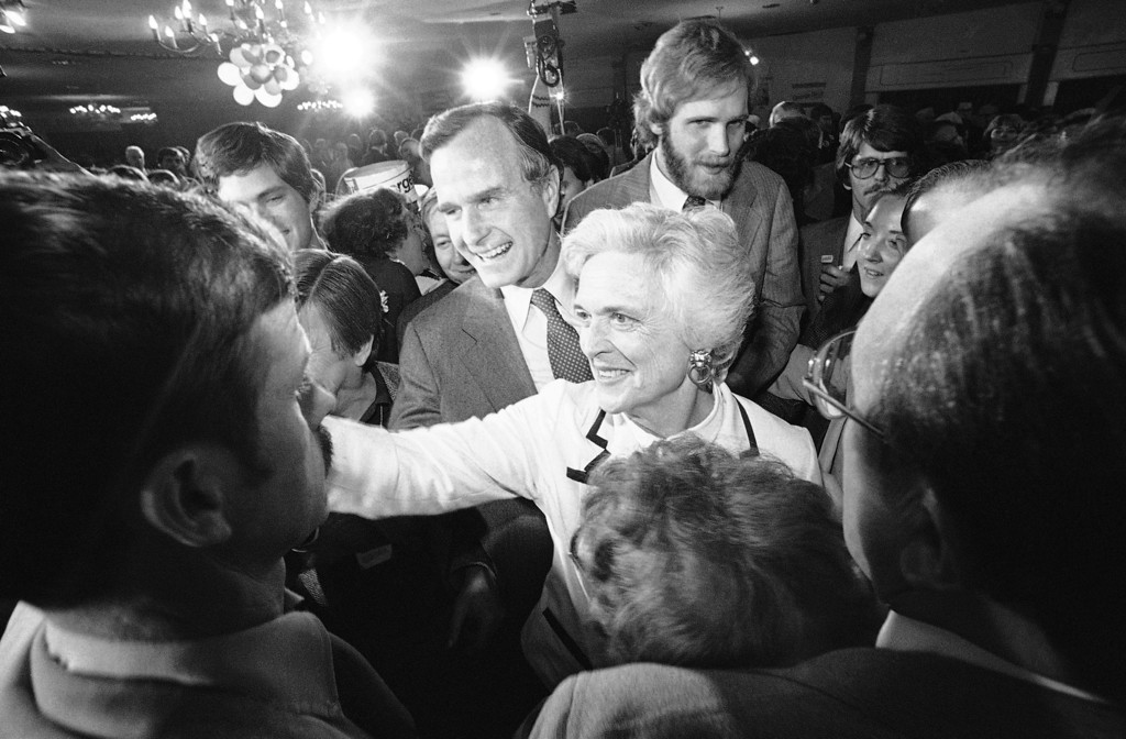 . Former CIA director George Bush and his wife, Barbara, smile and shake hands with supporters as Bush left a Concord hotel ballroom after he spoke with supporters in Concord on Tuesday, Feb. 26, 1980. Bush, who was seeking the Republican presidential nomination, received 22 percent of the vote, while rival Ronald Reagan received 52 percent. (AP Photo)
