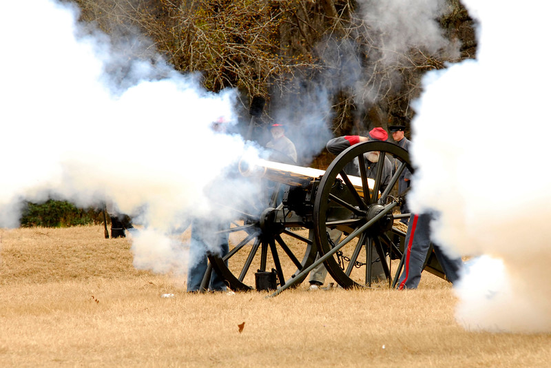 Smoke obscures a Confederate artillery bronze Parrott Riffle. The Skirmish at Gamble's Hotel happened on March 5, 1885 when 500 federal soldiers, under the command of Reuben Williams of the 12th Indiana Infantry, marched into Florence to destroy the railroad depot but were met by Confederate soldiers backed up with 400 militia. The reenactment, held by the 23rd South Carolina Infantry, was held at the Rankin Plantation in Florence, South Carolina on Saturday, March 5, 2011. Photo Copyright 2011 Jason Barnette
