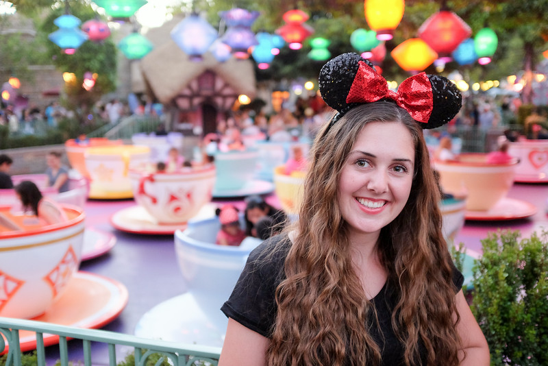 Kaitlin at the Tea Cup ride in Disneyland.