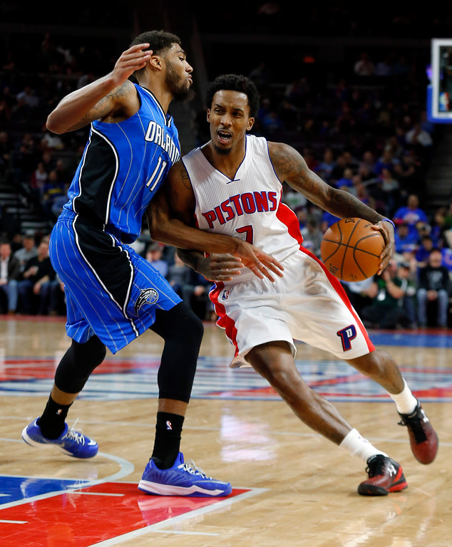 . Detroit Pistons guard Brandon Jennings (7) drives against Orlando Magic guard Devyn Marble (11) in the second half of an NBA basketball game in Auburn Hills, Mich., Wednesday, Jan. 21, 2015. (AP Photo/Paul Sancya)