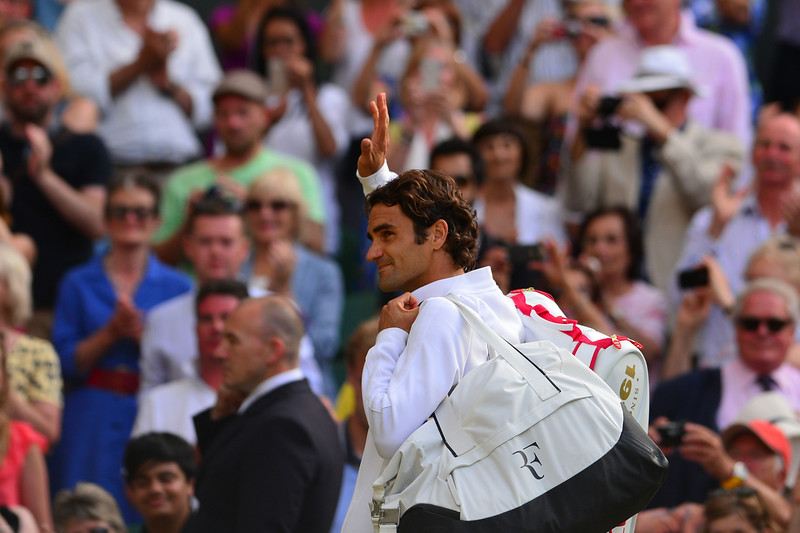. Switzerland\'s Roger Federer leaves Central Court after winning his men\'s singles semi-final match against Canada\'s Milos Raonic on day 11 of  the 2014 Wimbledon Championships at The All England Tennis Club in Wimbledon, southwest London, on July 4, 2014. Federer won 6-4, 6-4, 6-4. (CARL COURT/AFP/Getty Images)