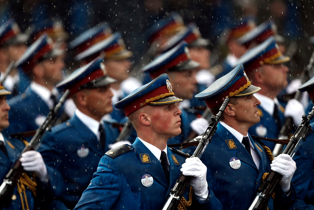 . Serbian army Honor Guard members march during a military parade in Belgrade, Serbia, Thursday, Oct. 16, 2014. (AP Photo/Marko Drobnjakovic)