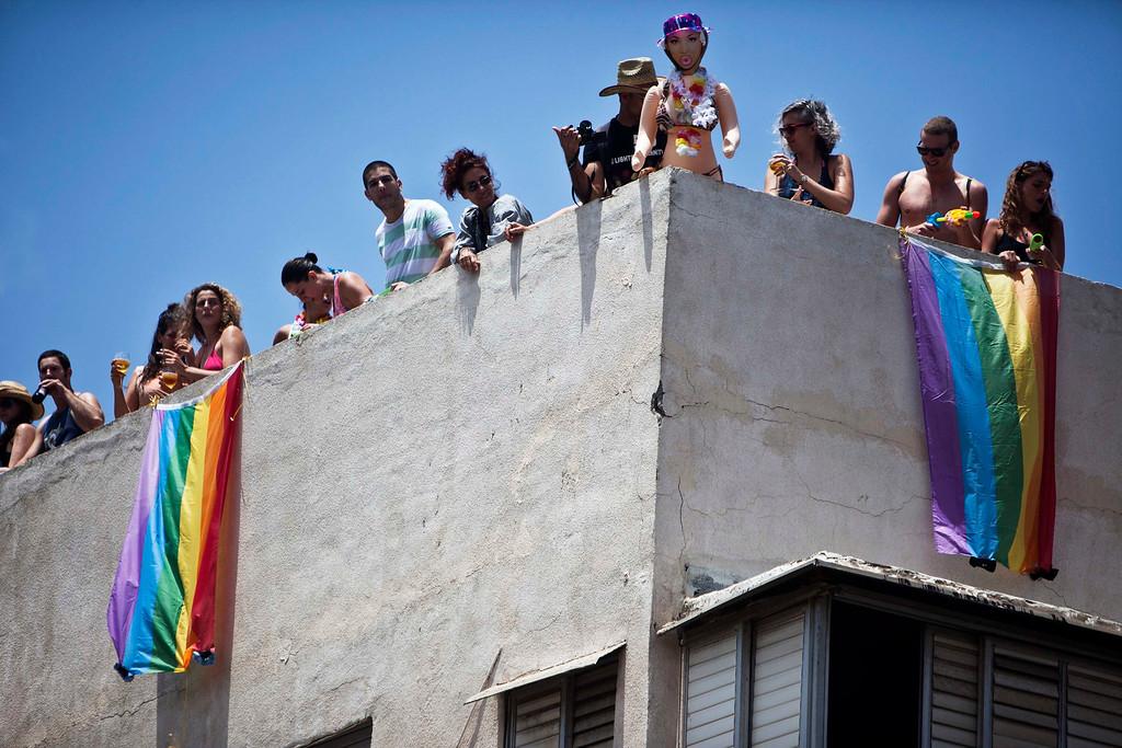 . People take part at the annual Gay Pride parade from their rooftop in Tel Aviv June 7, 2013.  REUTERS/Nir Elias