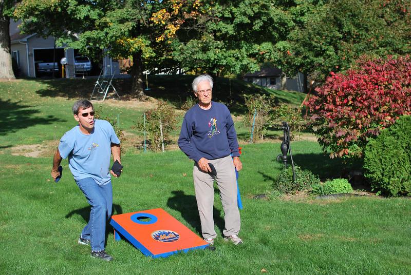 Rick and Dad playing cornhole.