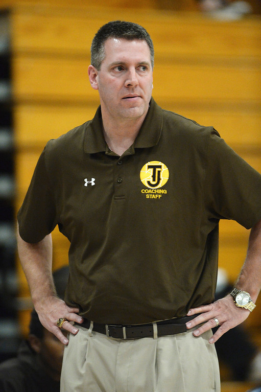 . Thomas Jefferson coach Grant Laman watched from the bench in the first half.  Photo By Karl Gehring/The Denver Post