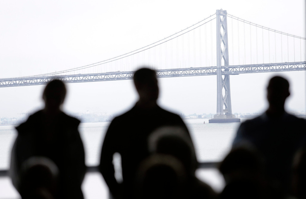 """. The Bay Bridge is in the background of a news conference regarding the  Artemis Racing Team catamaran that capsized Thursday in San Francisco, Calif. on Friday, May 10, 2013. Two-time Olympic medalist, Andrew \""""Bart\"""" Simpson was killed yesterday afternoon when the Artemis Racing team\'s 72-foot catamaran capsized during a practice run for America\'s Cup in the San Francisco Bay. Simpson was trapped beneath the boat and died after efforts to revive him failed.  (Gary Reyes/ Bay Area News Group)"""