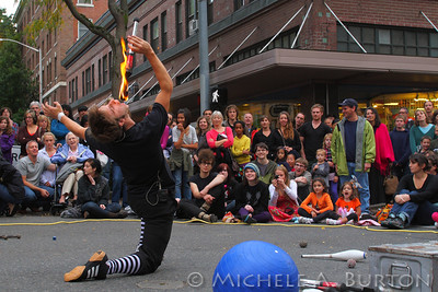 Juggler performing the fire eating trick at Olympia's semi-annual Arts Walk event