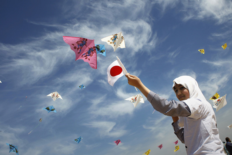 . Palestinian children fly kites bearing the Palestinian and Japanese flags to show their solidarity with Japan near a Japanese-funded housing project in Khan Younis in the southern Gaza Strip March 11, 2014. The event was organized by the United Nations Relief and Works Agency (UNRWA) to mark the third anniversary of the March 11 earthquake and tsunami in Japan that killed thousands. (SAID KHATIB/AFP/Getty Images)