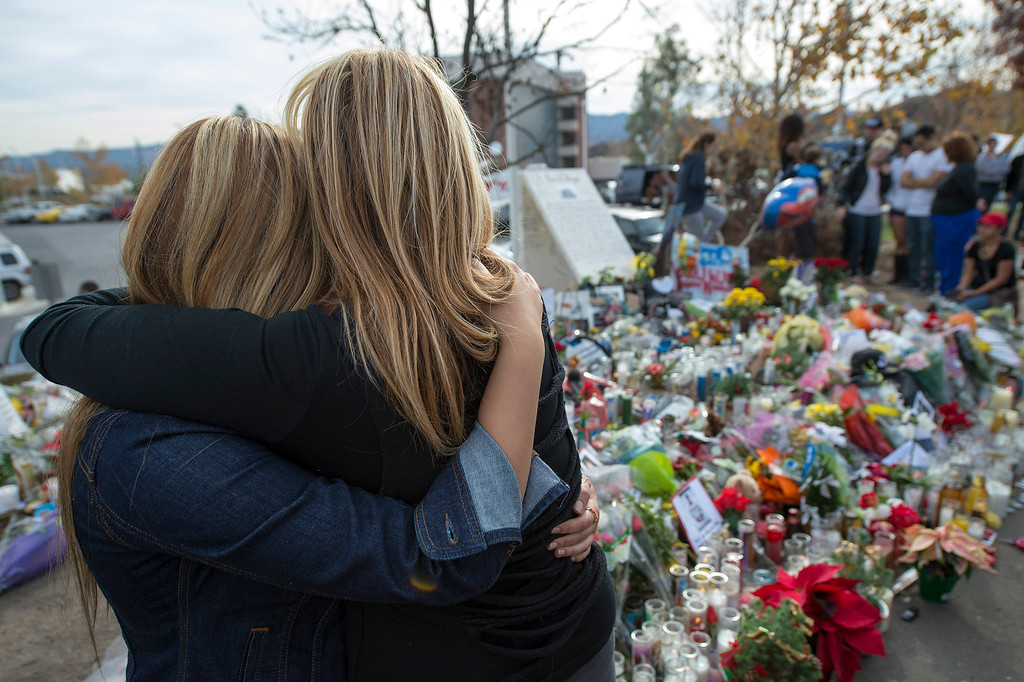 . Friend of Paul Walker Marjan Bauman, Woodland Hills, and daughter Alexandra, 16-years-old, pay their respects at a memorial the actor who was killed on Saturday, November 30, 2013 in Valencia, Ca. Walker was in a 2005 Porsche Carrera GT, believed to be driven by his friend Roger Rodas, that crashed and burst in to flames killing both occupants. (Photo by Hans Gutknecht/Los Angeles Daily News)