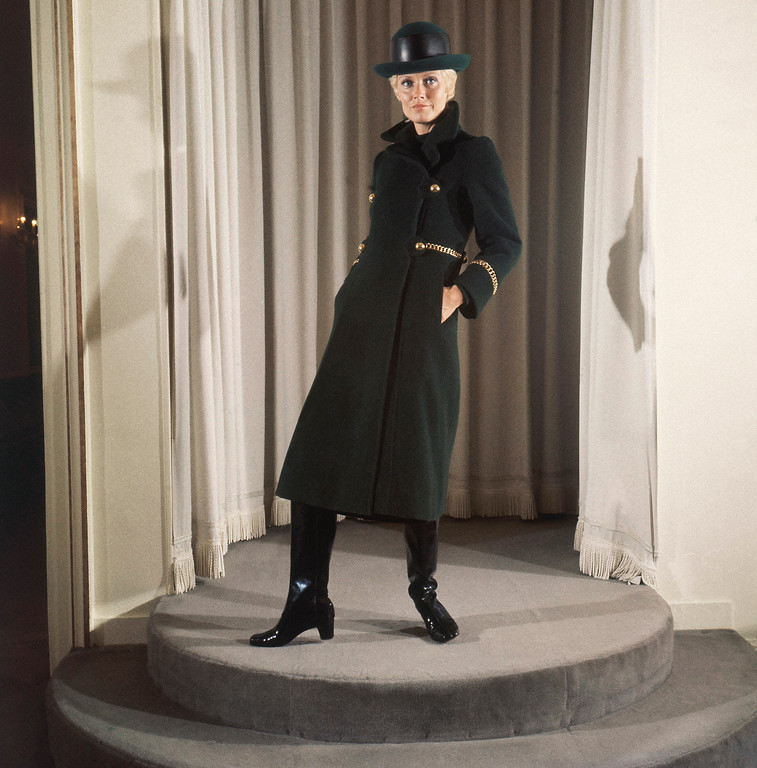 . A green wool coat with four golden buttons and golden belt, green fedora bowier hat with black leather patch and black leather boots, August 11, 1970. From the Pierre Balmain autumn/winter collection for 1970. (AP Photo/Marqueton)