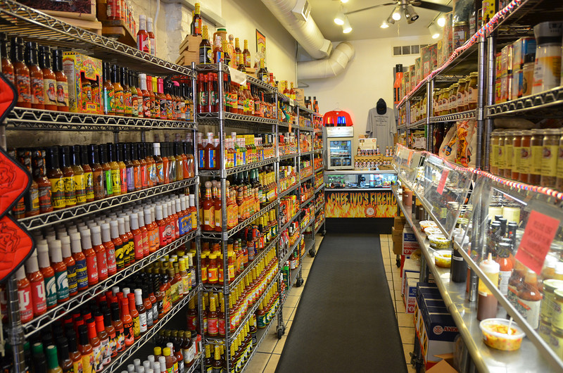 Shelf after shelf of hot sauces and condiments in the Galena Canning Company store.