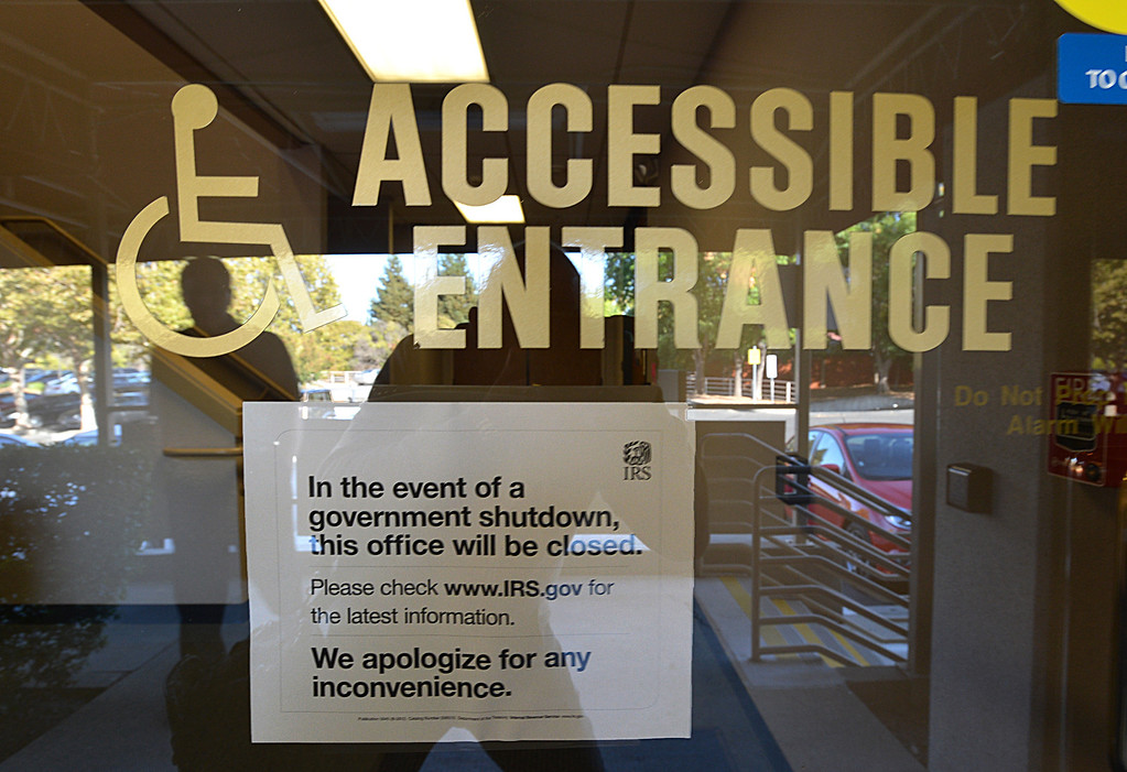 . A sign on the door of the Internal Revenue Office tells people they are closed during the federal government shutdown in Walnut Creek, Calif., on Tuesday, Oct. 1, 2013.  Tuesday was the first day of the federal government shutdown.   (Dan Rosenstrauch/Bay Area News Group)
