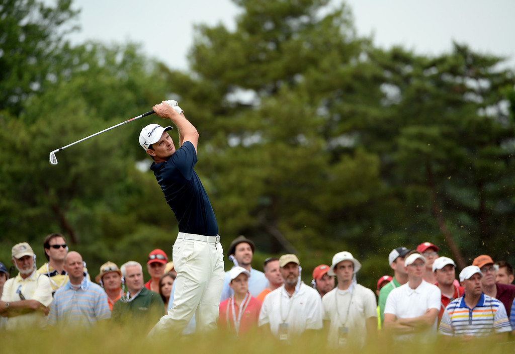 . ARDMORE, PA - JUNE 16:  Justin Rose of England hits his tee shot on the ninth hole during the final round of the 113th U.S. Open at Merion Golf Club on June 16, 2013 in Ardmore, Pennsylvania.  (Photo by Ross Kinnaird/Getty Images)
