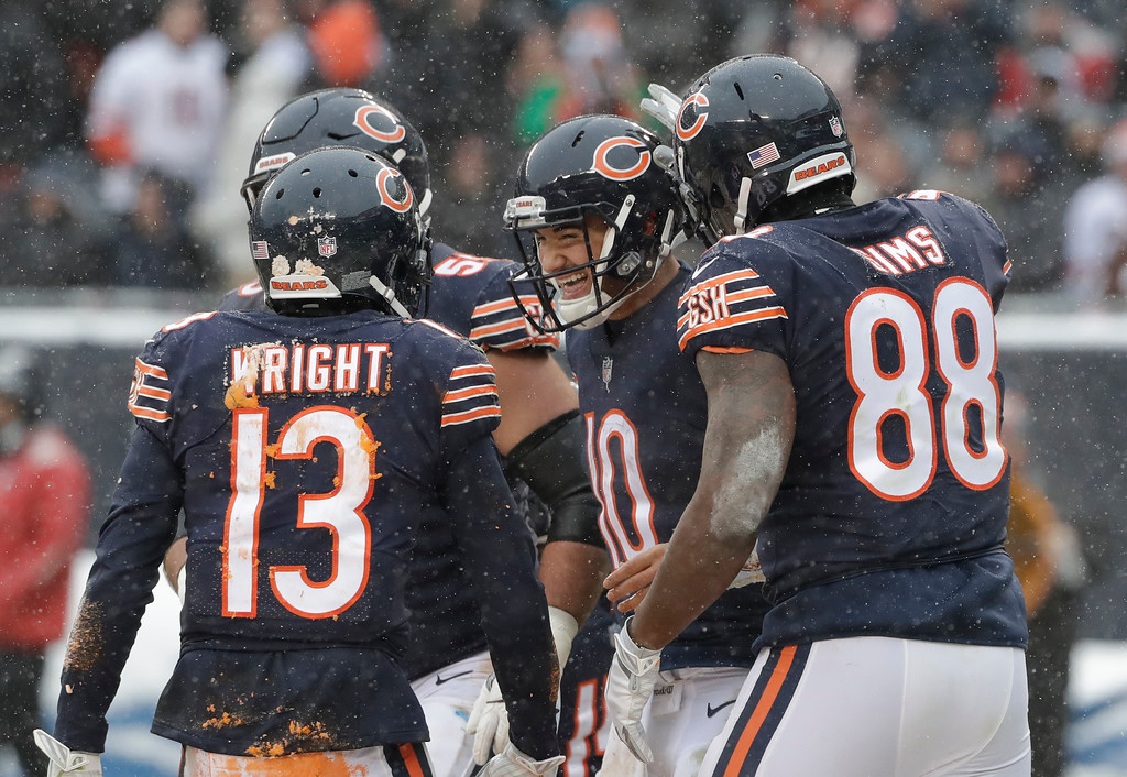 . Chicago Bears quarterback Mitchell Trubisky (10) celebrates his four yard touchdown run against the Cleveland Browns in the second half of an NFL football game in Chicago, Sunday, Dec. 24, 2017. (AP Photo/Nam Y. Huh)
