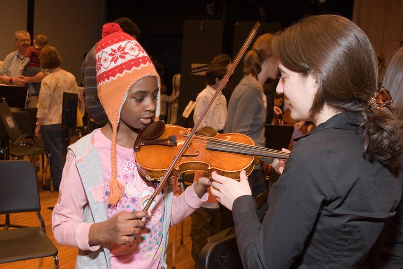 Lisa Rosinsky, violin, with child -- Hopkins Symphony Orchestra, March 2008