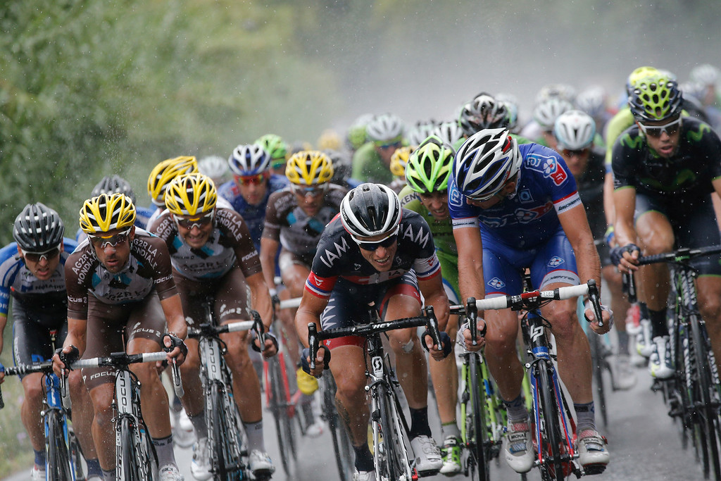 . Sylvain Chavanel of France, center, listens to another rider in the pack during the fifteenth stage of the Tour de France cycling race over 222 kilometers (137.9 miles) with start in Tallard and finish in Nimes, France, Sunday, July 20, 2014. (AP Photo/Christophe Ena)