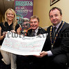 Orla jackson, CEO Newry Chamver of Commerce and David Hanna, President of Newry Chamber of Commerce present Mayor Pat McGinn with a cheque for £3250 proceeds from a charity prize draw at the recent Business Awards. 06W23N31