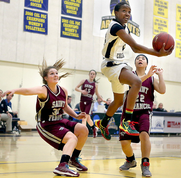 . Pacific Collegiate High\'s Morgan Green soars between two St. Francis players at Notre Dame de Namur University in Belmont on Friday night during the CCS Division V Championship game. (Kevin Johnson/Sentinel)