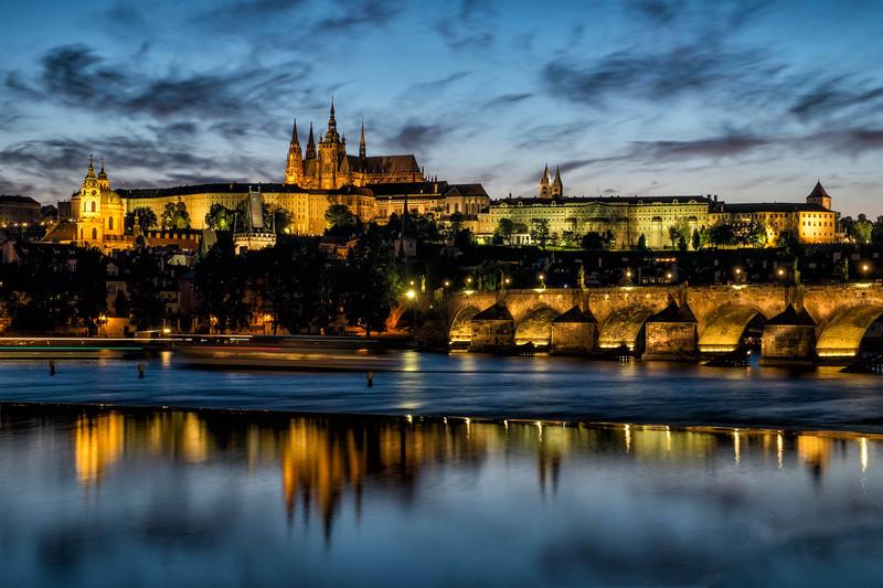 Night view of Charles Bridge and Lobkowicz Palace, Prague, Czech Republic.