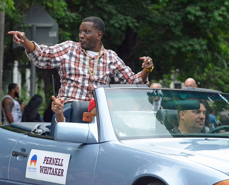 KYLE MENNIG - ONEIDA DAILY DISPATCH Pernell Whitaker gestures to the crowd during the International Boxing Hall of Fame Induction Weekend Parade of Champions in Canastota on Sunday, June 12, 2016.