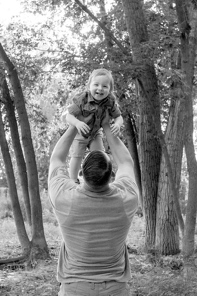 little boy smiling big during family photos at boise river .jpg