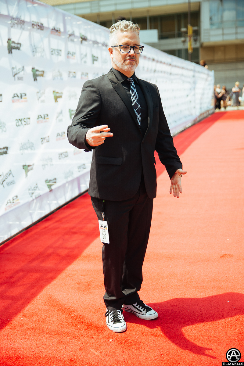 Mike Shea, CEO & Founder of Alternative Press on the red carpet at the APMAs 2015 by Adam Elmakias